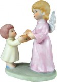 Angel Offering Cookie to Young Child Figure
